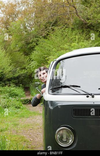 Young man in camper van - Stock Image