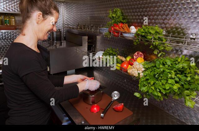 Woman cooking vegan food, UK - Stock Image
