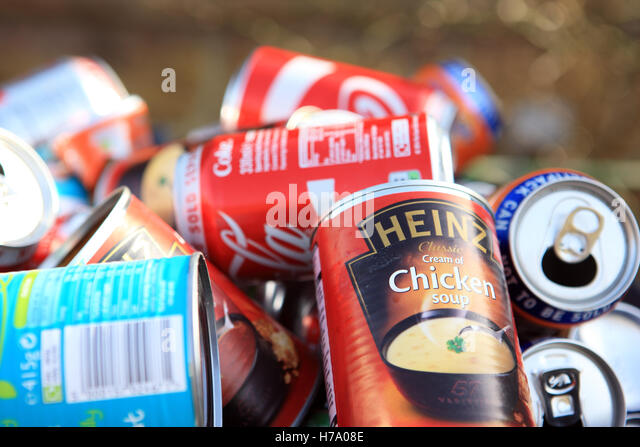 Empty cans in an overflowing recycle bin in Scotland - Stock Image