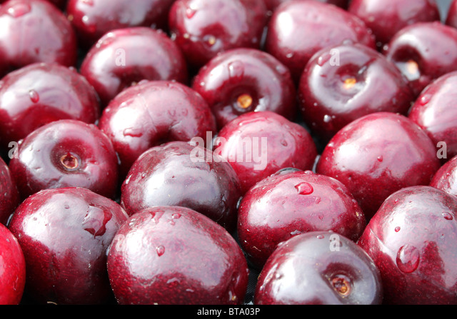 Sweet red cherry (Prunus Avium) placed together at a background - centre focus - Stock-Bilder