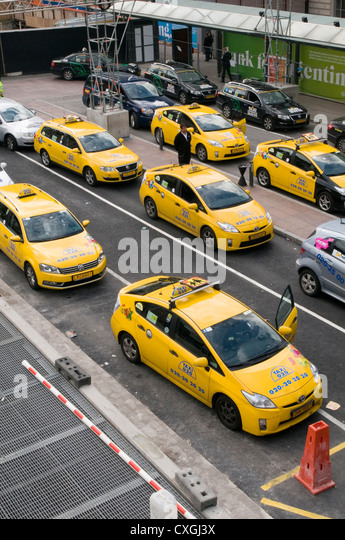 Toyota prius hybrid taxi taxis car cars in stockholm sweden - Stock Image