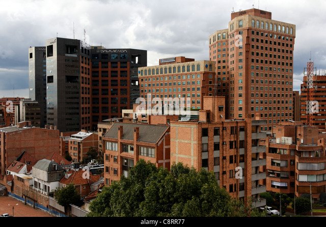 A contrast of modern and traditional buildings in the financial quarter of Bogota, Colombia - Stock Image