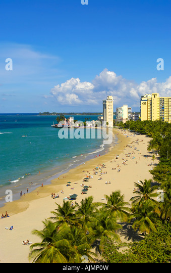 San Juan Puerto Rico Isla Verde Caribbean islands, famous beach with sunbathers, blue sky and resort hotels in background, - Stock Image