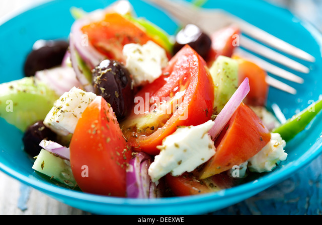authentic greek salad with olive oil and oregano - Stock Image