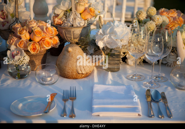wedding table decoration orange luxury clay gifts items luxury ceremonial party art artifacts artist cutlery design - Stock Image