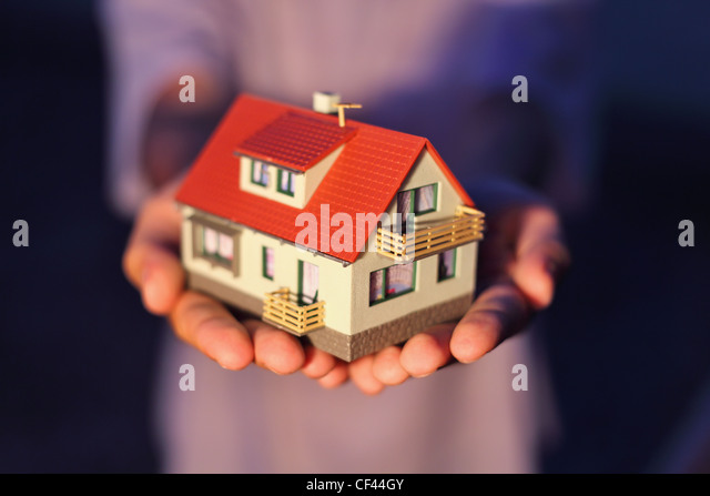 model of house on hands - Stock Image