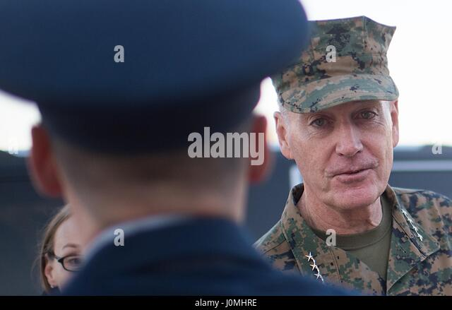 Joseph F Dunford, the chairman of the Joint Chiefs of Staff, talks with an Airman before boarding an aircraft at - Stock Image