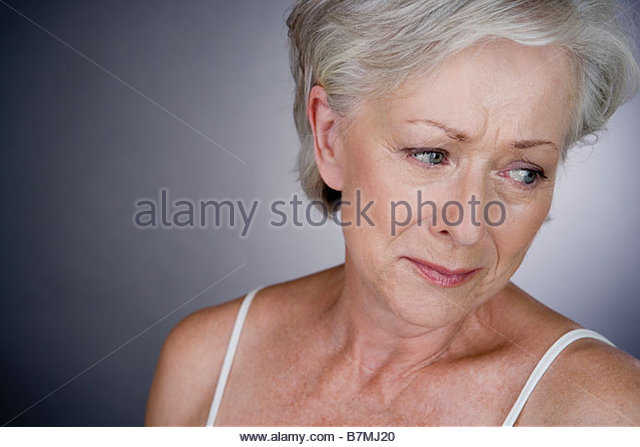 A senior woman crying - Stock Image