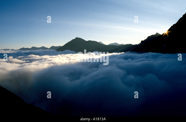 Early morning above a cloud sea in the Cirque de Gavarnie, Pyrenees, France - Stock Image