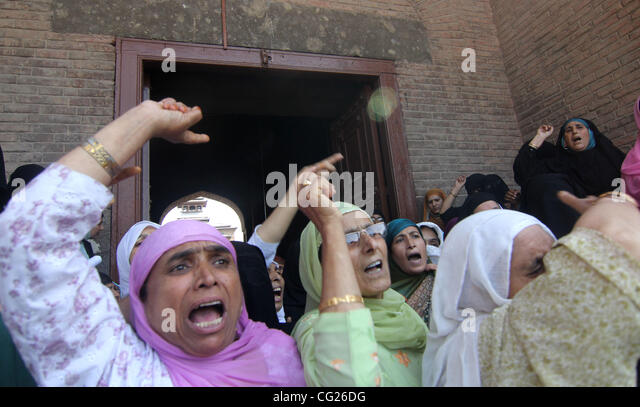 kashmir muslim women shout slogans  during protest against the custodial death of a youth  in srinagar, the summer - Stock Image