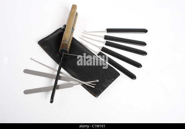 A set of amateur and professional lock picks; including a steel rake, tension bar, wrench and brass Coldseal door - Stock Image
