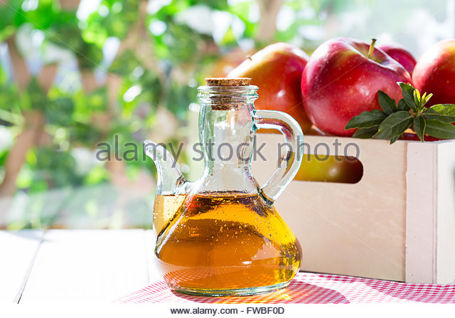 Apple cider vinegar with a fresh apple - Stock Image