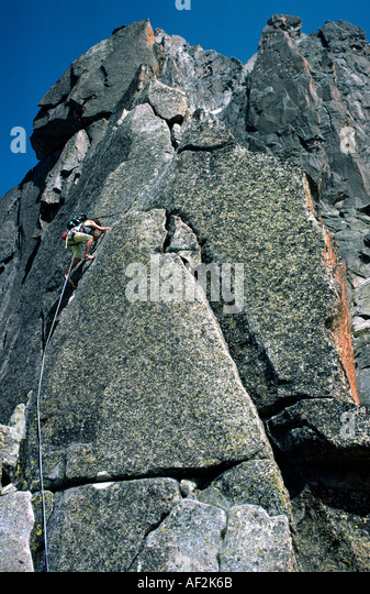 Rock climbing the Arete de Papillons Massif du Mont Blanc Chamonix France - Stock Image