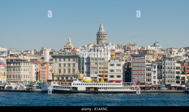 Istanbul, Turkey - April 26, 2017: City view of Istanbul, Turkey from the sea overlooking Galata Tower and Karakoy - Stock Image