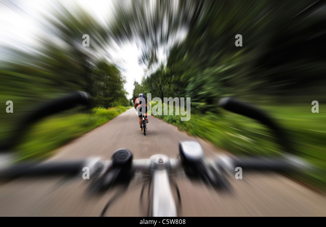Germany, Bavaria, Munich, Person road cycling, rear view - Stock Image