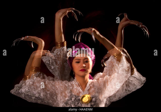 A multi-exposure photo showing the graceful movements of a dancer wearing the 'janggay' or 'fingernail - Stock Image