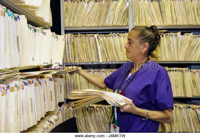 Miami Florida Borinquen Health Care Center clinic optometrist office patient records manila folders shelf privacy - Stock Image