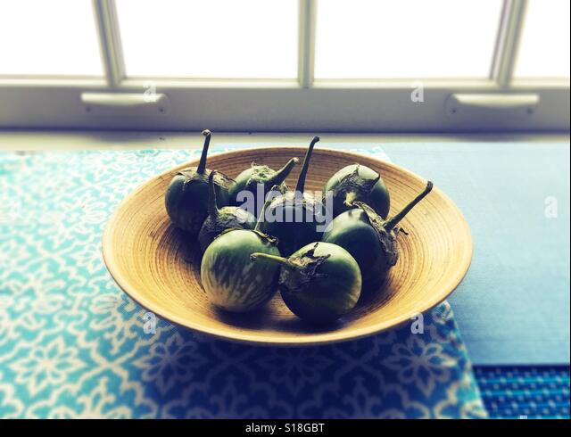 Thai eggplants in a bowl. - Stock Image