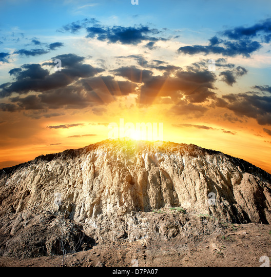 Scenic yellow rock in the rays of evening sun - Stock Image