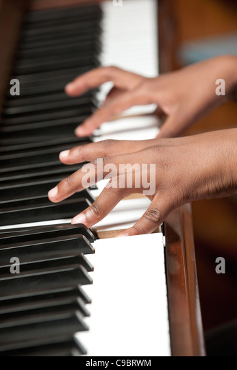 Childs hands playing piano, Johannesburg, Gauteng Province, South Africa - Stock Image