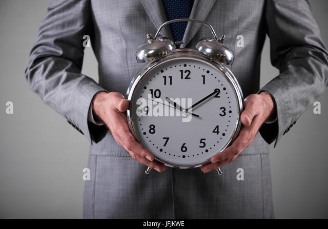 Businessman with clock in business concept - Stock Image