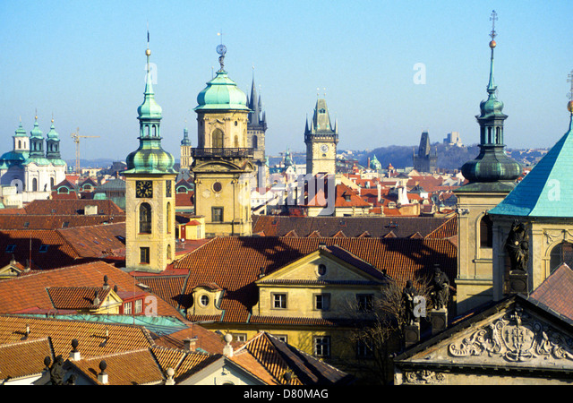 View over rooftops with church towers and domes, Prague, Czech Republic - Stock Image