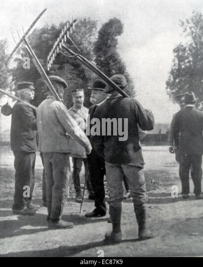 Photograph of Prime Minister Clemenceau of France visiting farm workers during World War One. Dated 1916 - Stock Image
