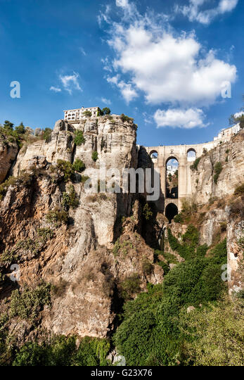 Spain Andalucia, Ronda, Parador , Puente Nuevo spanning the gorge of the Rio Guadalevin - Stock Image