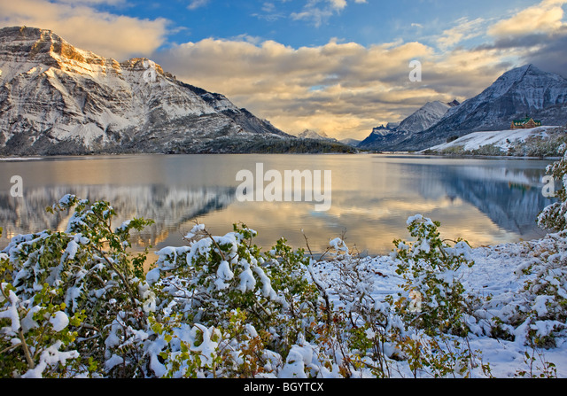 Prince of Wales Hotel opposite Mt Vimy and overlooking Middle Waterton Lake after the first snowfall of winter, - Stock Image