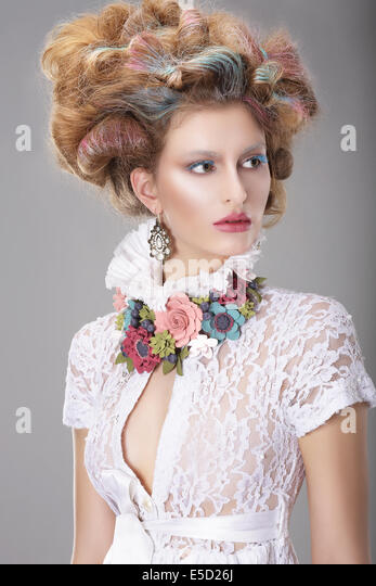Elegant Charismatic Woman with Fancy Hairstyle - Stock Image