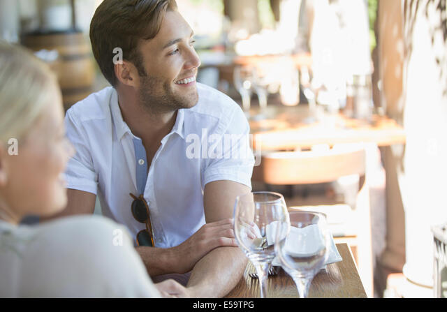 Couple sitting together in restaurant - Stock Image