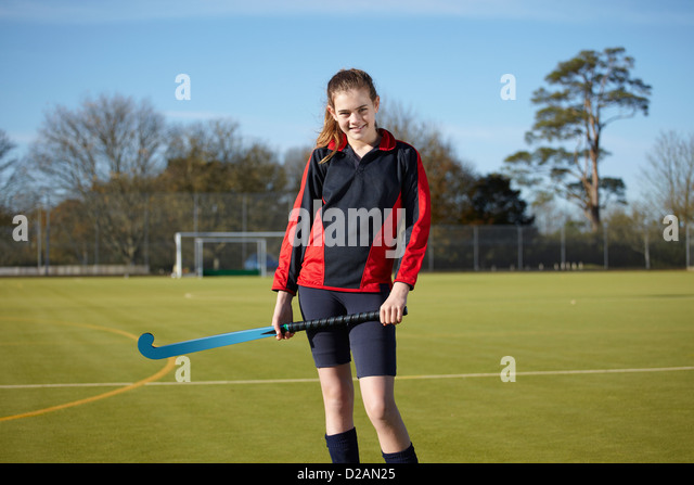 Lacrosse player standing on field - Stock Image