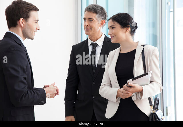 Business associates chatting - Stock Image