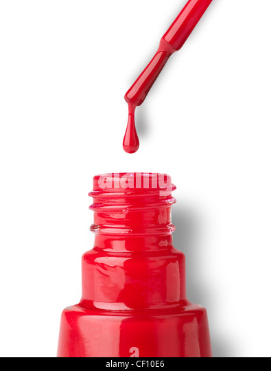 A still life shot of a a dripping nail varnish brush and bottle - Stock Image