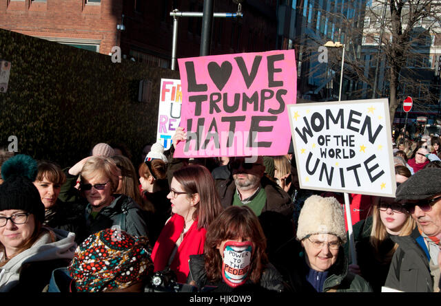 Women's anti-Trump march, London. Placards saying 'Love trumps hate' and 'Women of the world unite'. - Stock Image
