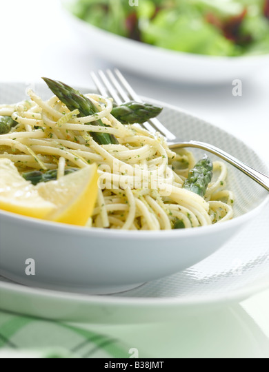 pesto pasta with asparagus - Stock Image