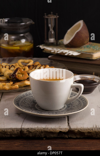 Tea & Coconut cookies in the kitchen. Recipe - Stock Image