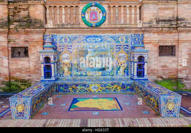 Glazed tiles bench of spanish province of Soria at Plaza de Espana, Seville, Spain - Stock Image