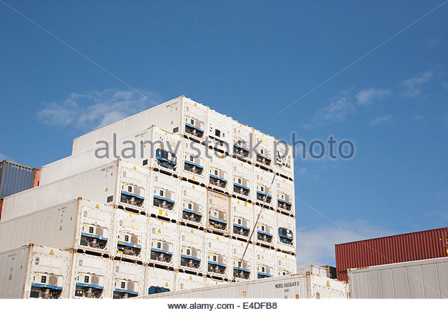 Cargo containers in dockyard - Stock Image