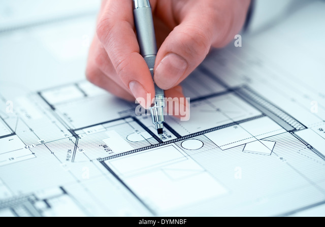 Woman Architect drawing on blueprint construction project - Stock Image