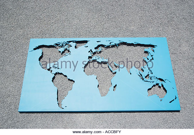 World map on gravel - Stock Image
