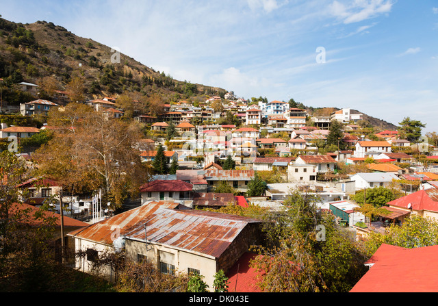 Pedoulias village clinging to the side of the Troodos mountains, Cyprus. - Stock Image