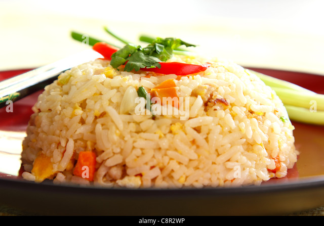 Fried rice with vegetable ,egg and pork - Stock Image