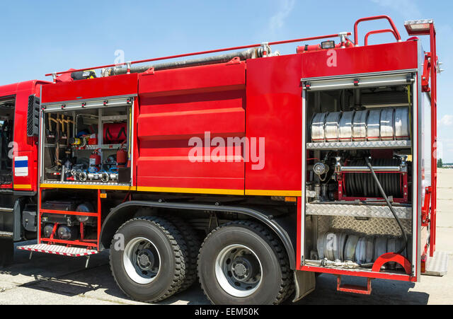 Equipment used in firefighting installed on a modern fire truck - Stock Image