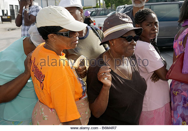 Miami Florida Little Haiti Thanksgiving Turkey Give-Away give away Haitian Black woman women assistance community - Stock Image
