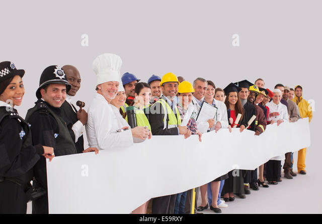 Portrait of diverse workforce with blank signs - Stock Image