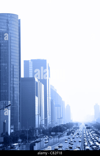 Perspective of avenue in haze toned in blue color, Beijing, China - Stock Image