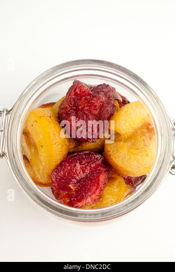 Fruit in a glass jar - Stock Image