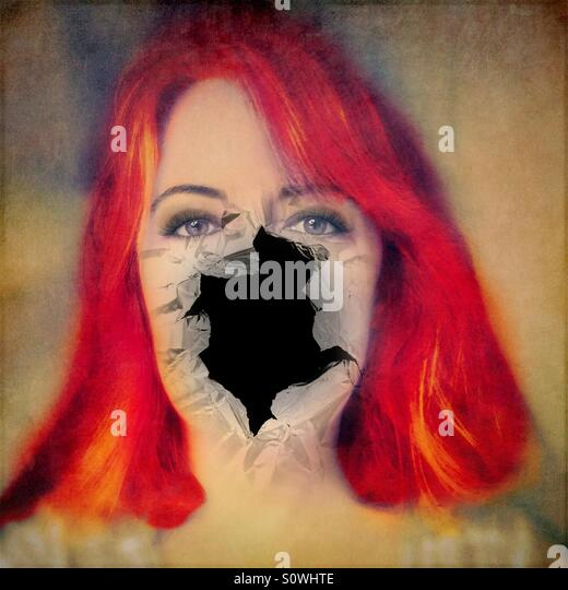 Woman With Red Hair With Hole in Face - Stock Image