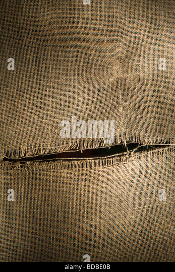 Torn, Hessian cloth. - Stock Image